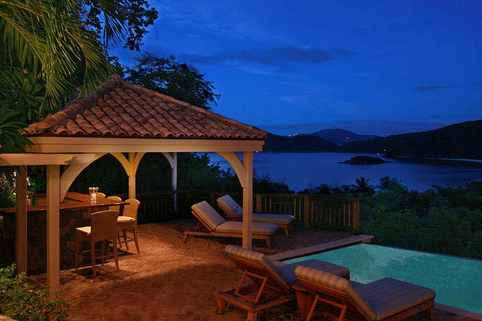 The Sunspot Pool Bar And Pool Deck At Dusk With A Beautiful View Of  Tortola, British Virgin Islands In The Distance